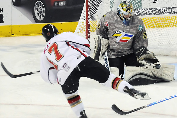 Colorado Eagles goalie Kyle Jones stops a shot by Rapid City Rush forward Scott Wray in the first period of their game on Wednesday, November 10, 2010 at the Budweiser Events Center.