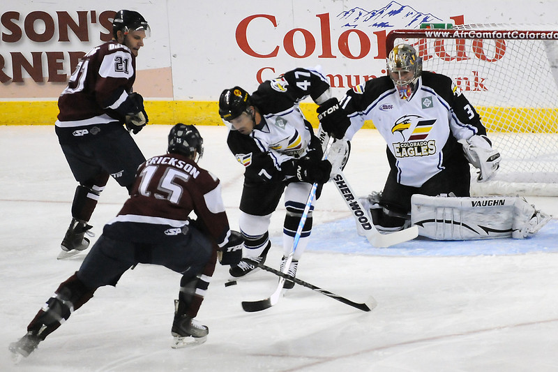 Colorado Eagles goalie Andrew Penner and forward Scott May work against Tulsa Oilers players Jack Combs (21) and Sean Erickson (15) in the first period of their game Friday at the Budweiser Events Center.
