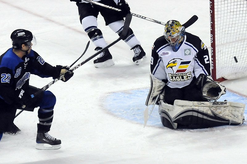 Colorado Eagles goalie Kyle Jones deflects a shot while Wichita Thunder forward AJ Gale looks on in the first period of their game on Friday, Nov. 26, 2010 at the Budweiser Events Center.