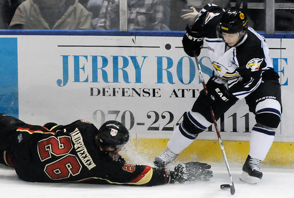 Colorado Eagles center Riley Nelson battles for the puck along the boards with fallen Rapid City Rush defenseman Jamie VanderVeeken in the first period of their game on Wednesday, Nov. 24, 2010 at the Budweiser Events Center.
