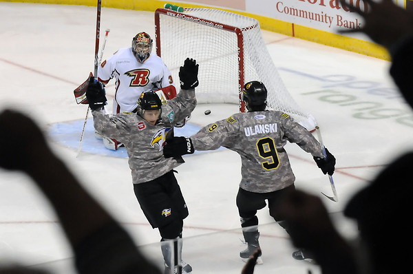 Colorado Eagles player Riley Nelson, left, is congratulated by teammate Kevin Ulanski after Nelson scored a goal on Rapid City Rush goalie Danny Battochio in the first period of their game on Wednesday, November 10, 2010 at the Budweiser Events Center.