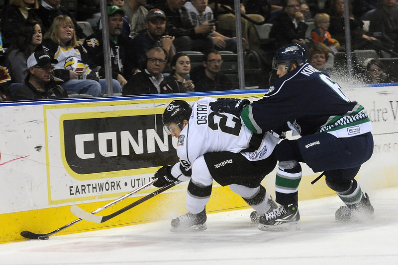 Colorado Eagles forward Kyle Ostrow, left, and Florida Everblades defenseman Tommi Kivisto track down the puck along the boards in the first period of their game Wednesday, Nov. 21, 2012 at the Budweiser Events Center.
