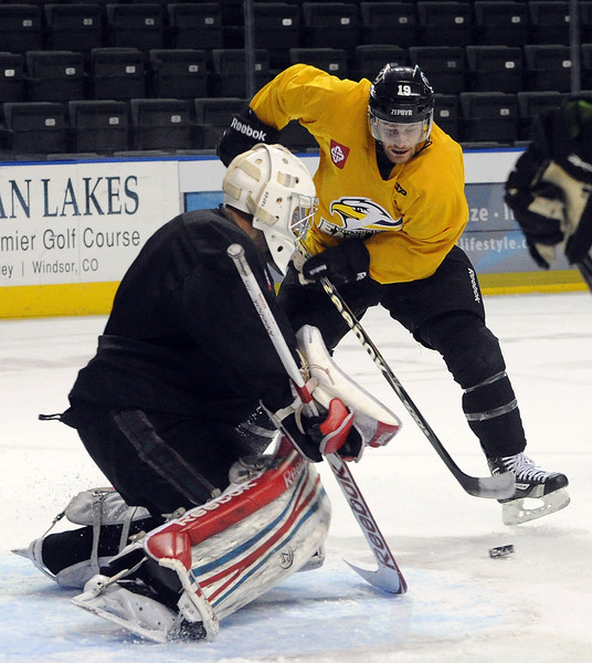 Colorado Eagles hockey player #19 Joey Sides during practice Wednesday, October 31, 2012.
