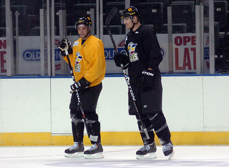 Colorado Eagles players and brothers AJ Hau, left, and Chris Hau chat during the first practice Monday at the Budweiser Event Center in Loveland.