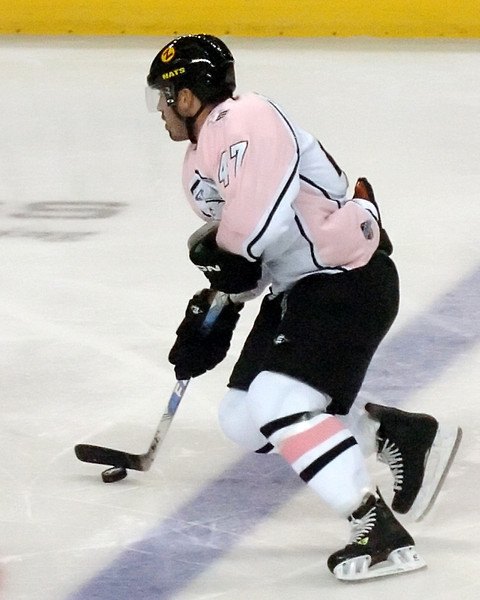 Colorado Eagles forward Scott May skates with the puck during the second period of a game against the Odessa Jackalopes on Saturday, Oct. 2, 2010 at the Budweiser Events Center.