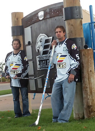Colorado Eagles players Daymen Rycroft, left, and Kyle Peto stand in front of the Boundless Playground sign at Boardwalk Park in Windsor on Tuesday, Oct. 12, 2010.
