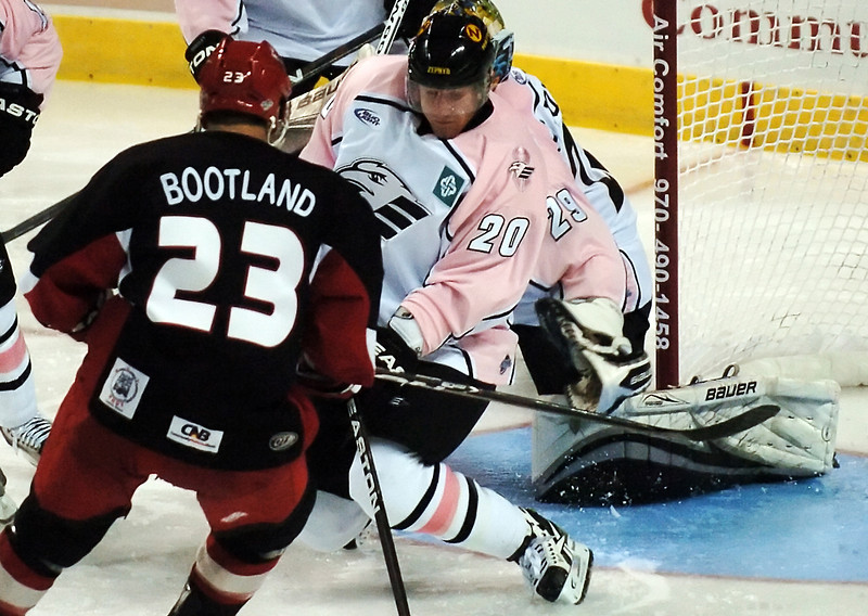 Colorado Eagles defenseman Jason Beatty (20) works in front of the net during a game against the Odessa Jackalopes on Saturday, Oct. 2, 2010 at the Budweiser Events Center.