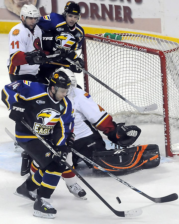 Colorado Eagles winger Brett Lutes, front, battles in front of the net for the puck as teammate Ed McGrane looks on in the first period of a game against the Arizona Sundogs on Friday, Feb. 26, 2010 at the Budweiser Events Center.