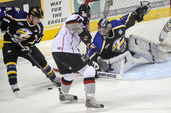 Colorado Eagles goalie Andrew Penner and defenseman Jim Jackson deflect a shot by Amarillo Gorillas center Stuart MacRae in the second period of their game on Wednesday, Feb. 24, 2010 at the Budweiser Events Center. Penner stopped 23 Gorillas shots in the Eagles' 3-0 victory.