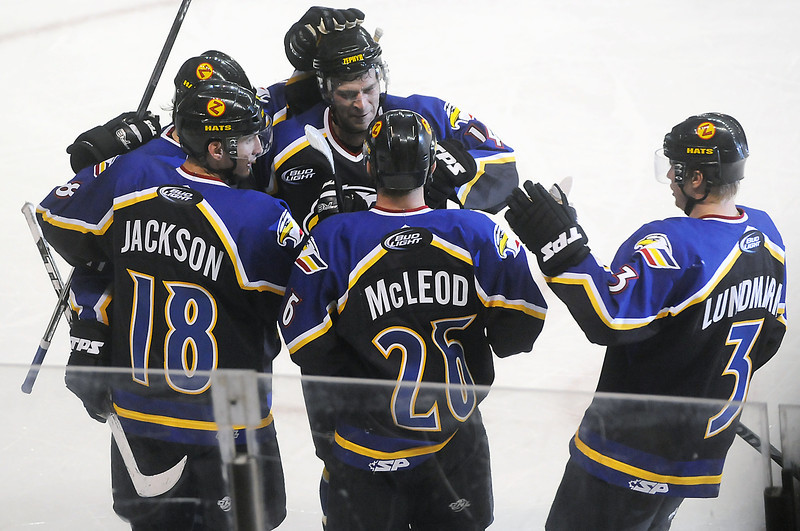 Colorado Eagles defenseman Jim Jackson, left, is congratulated by teammates after scoring a goal in the second period of a game against the Amarillo Gorillas on Wednesday, Feb. 24, 2010 at the Budweiser Events Center.