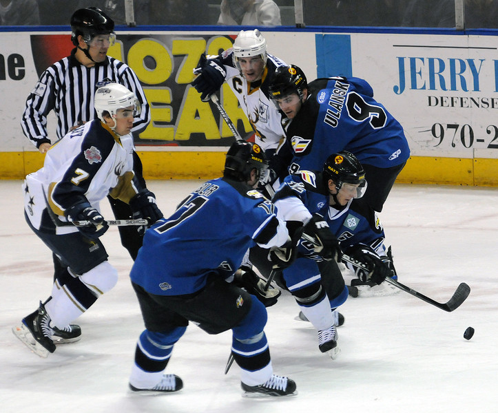 Colorado Eagles forward Riley Nelson squeezes through teammates Ryan Tobler, foreground, and Kevin Ulanski as Mark O'Leary, left, and Adam Rivet, background, try to get in on the action during the first period of Wednesday night's game at the Budweiser Events Center. The Laredo Bucks won the game 4-2.