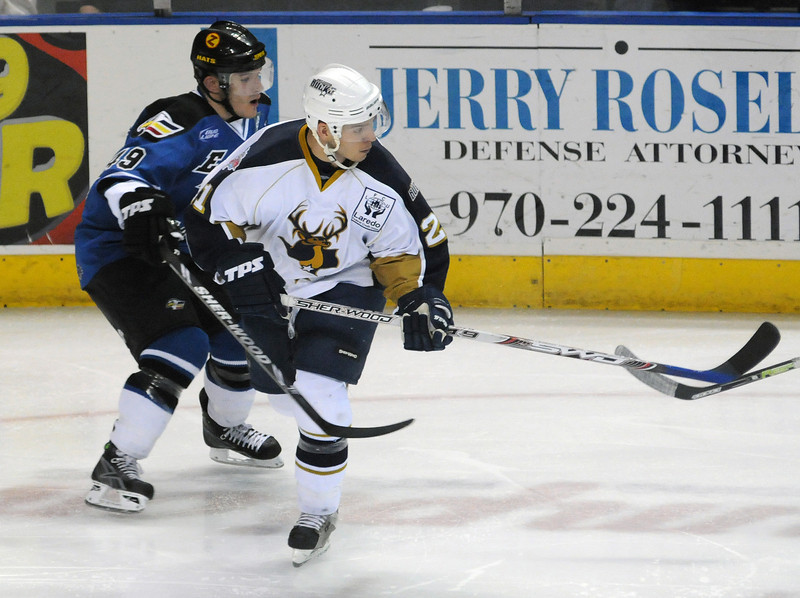 Colorado Eagles defensman Felipe Larranaga, left, tangles with forward Todd Griffith of the Laredo Bucks during the second period of a game on Jan. 20 at the Budweiser Events Center.