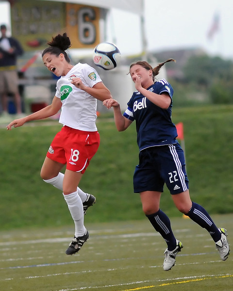 Rebekah Patrick of the Colorado Force, left, goes up for the ball against Vancouver Whitecaps midfielder Kelsey Hood in the first half of their match Friday evening at the Loveland Sports Park.