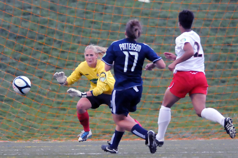 Colorado Force goalie Hannah Clark defends on a shot attempt by Vancouver Whitecaps forward Carrie Patterson (17) while Jen Thomas looks on in the first half of their match Friday at the Loveland Sports Park.