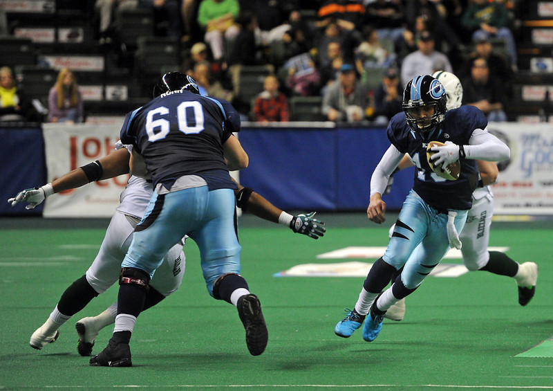 Colorado Ice quarterback Willie Copeland escapes pressure and runs for a long touchdown to put the Ice up 24 to 20 during the fourth quarter of a game at The Budweiser Event Center, Sunday in Loveland, Colo.