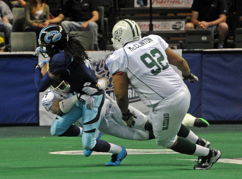 Colorado Ice wide receiver Mark Henderson is tackled by Green Bay Blizzard defensive back Elijah Fields during a kick return in the fourth quarter of a game at The Budweiser Event Center in Loveland, Colo.