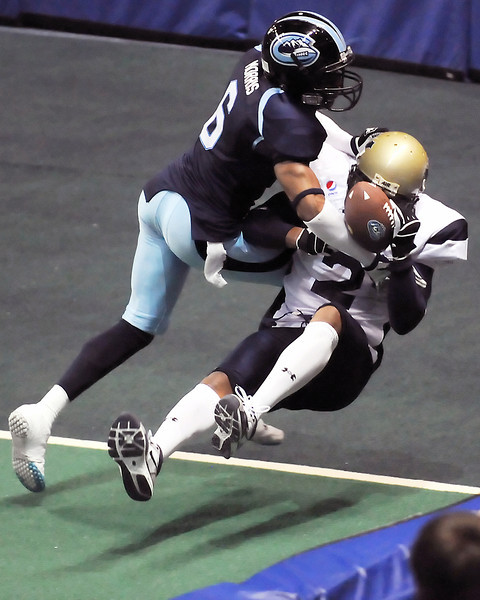 Colorado Ice defensive back Josh Morris, left, breaks up a pass intended for Wyoming Cavalry wide receiver James Newson in the third quarter of their game on Sunday, April 17, 2011 at the Budweiser Events Center. The Ice won, 59-54.