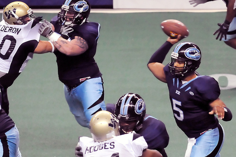 Colorado Ice quarterback Knighton David, right, rears back to throw a pass while teammates Jeffrey Younker, top, and Mason Barrett block for him in the third quarter of their game against the Wyoming Cavalry on Sunday, April 17, 2011 at the Budweiser Events Center. The Ice won, 59-54.