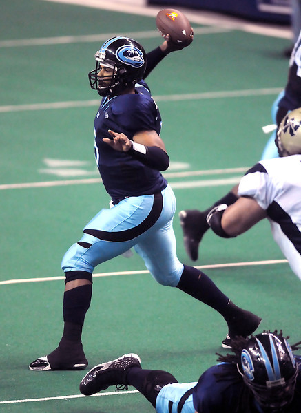 Colorado Ice quarterback David Knighton throws a pass in the second quarter of a game against the Wyoming Cavalry on Sunday, April 17, 2011 at the Budweiser Events Center. The Ice won, 59-54, to remain undefeated on the season.