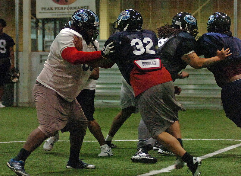 Colorado ICE offensive linemen #60, far left, and #78, Center right.
