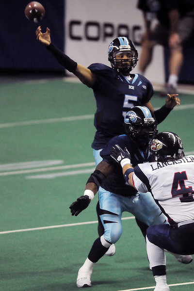 Colorado Ice quarterback David Knighton throws a pass while teammate Terry Washington blocks Allen Wranglers linebacker James Lancaster in the first quarter of their game on Saturday at the Budweiser Events Center.