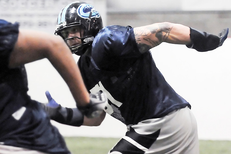 Colorado Ice defensive lineman Dominic Applehans runs a drill during practice Thursday, March 3, 2011 at Arena Sports in Windsor.