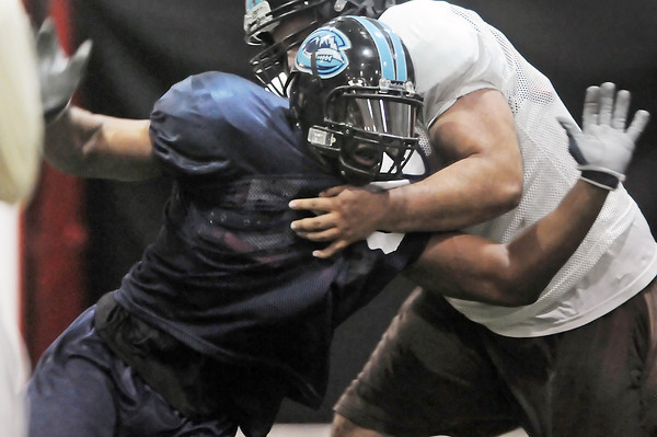 Colorado Ice defensive lineman Chase Vaughn, left, attempts to get around a block during practice Thursday, March 3, 2011 at Arena Sports in Windsor.