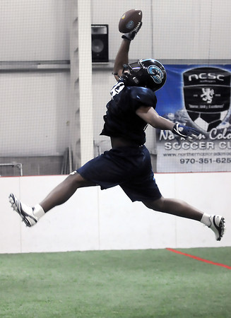 Colorado Ice defensive lineman Chase Vaughn makes a leaping one-handed catch while participating in a drill at practice Thursday, March 3, 2011 at Arena Sports in Windsor.