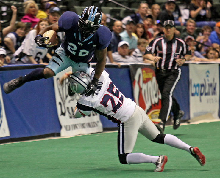 Colorado Ice running back Tobias Robinson (22) gets drilled in the open field by Allen Wrangler's kicker David Pino (25) during the 2nd quarter Sunday afternoon at the Budweiser Events Center. The Ice handed the Wranglers their first loss, winning 61-55.