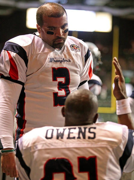 Allen Wranglers' quarterback Ben Sankey (3) listens to wide receiver Terrell Owens (81) Sunday at the Budweiser Events Center after Sankey failed to connect with Owens over consecutive Wranglers' offensive drives. The Wranglers' lost to the Colorado Ice 61-55.