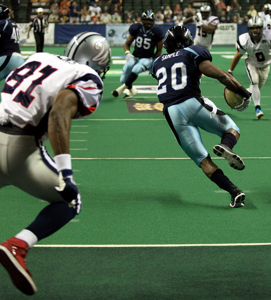 Defensive back Corey Sample (20) races out of the end zone and away from wide receiver Terrell Owens (81) with an interception in early action Sunday at the Budweiser Events Center where the Colorado Ice defeated the Allen Wranglers 61-55.