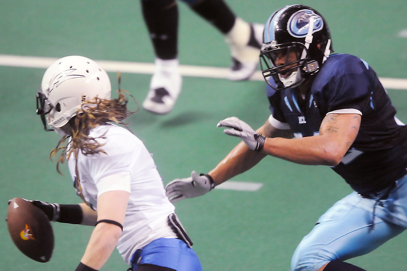 Colorado Ice linebacker Eryk Anders, right, pursues Arizona Adrenaline quarterback Dennis Havrilla in the third quarter of their game Sunday, May 1, 2011 at the Budweiser Events Center. The Ice won, 74-13.