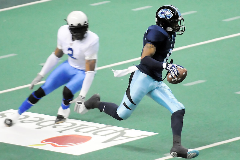 Colorado Ice defensive back Josh Morris, right, runs away from the Arizona Adrenaline's Billy Davis after making an interception in the fourth quarter of their game Sunday, May 1, 2011 at the Budweiser Events Center. The Ice won, 74-13.