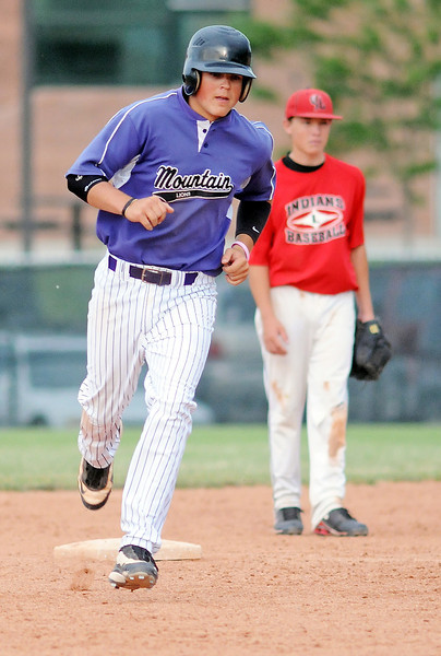 Davidson-Gebhardt Chevrolet second baseman Kylan Bakovich looks on as Brandon Baeckel of Johnson's Corner rounds the bases after hitting a grand slam in the bottom of the fifth inning of their game  Friday, June 25, 2010 at Brock Field. Johnson's Corner won, 14-10.