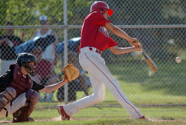 Silver Creek catcher Keenan Coder wirks behind the plate as Davidson-Gebhardt Chevrolet's Darius Coldiron hits a single in the bottom of the first inning of their game on Wednesday, June 30, 2010 at Swift Field. Loveland High School's top summer team won in five innings, 15-4.