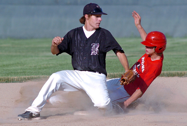 Davidson-Gebhardt Chevrolet's Jered Ratschkowsky slides safely into second base for a steal ahead of the tag by Silver Creek's Marcus Steward in the bottom of the second inning of their game on Wednesday, June 30, 2010 at Swift Field. Loveland High School's top summer team won in five innings, 15-4.