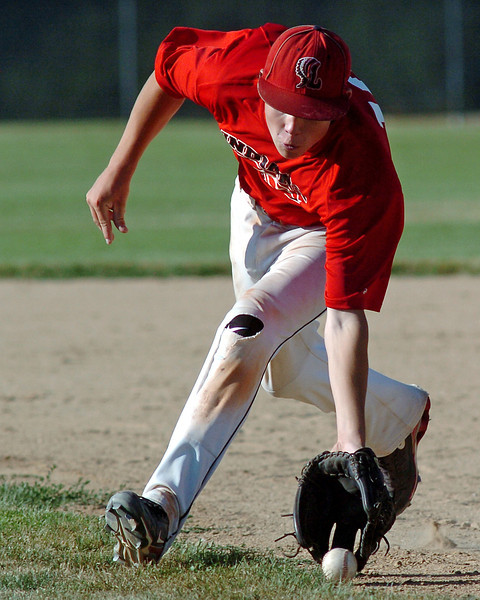 Davidson-Gebhardt Chevrolet second baseman Kylen Bakovich scoops up a ground ball before throwing it to first base for an out during a game against Silver Creek on Wednesday, June 30, 2010 at Swift Field.