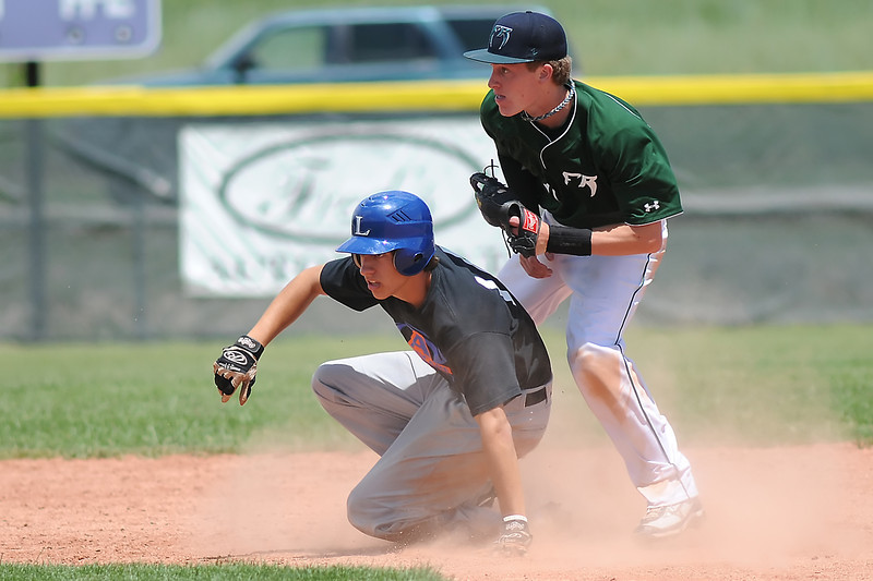 Fossil Ridge High School second baseman Logan Waterland, right, tags out Advocare baserunner Taylor Dudley on a steal attempt in the top of the fourth inning of their game Saturday at Brock Field.