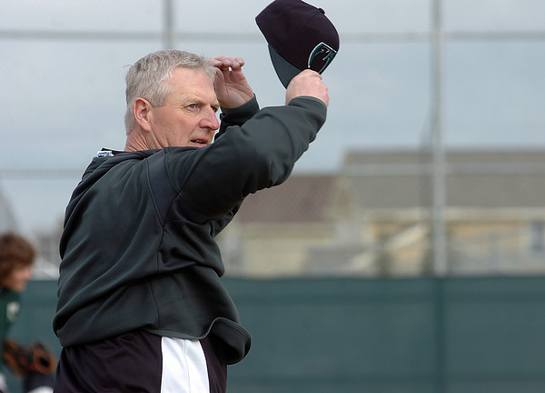 Coach Findley puts on a sweatshirt during a recent chiil practice at Fossil Ridge.