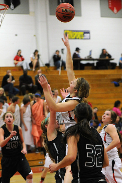 Loveland High School junior Addie Coldiron, top, puts up a shot over Fossil Ridge's Koree Willer in the third quarter of their game on Tuesday, Feb. 14, 2012 at LHS.