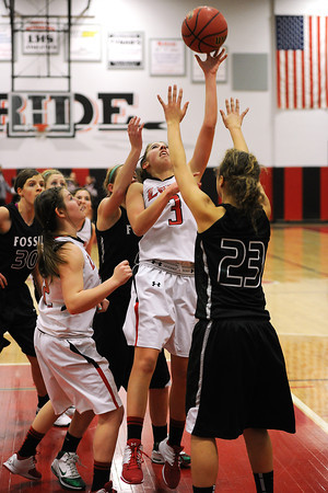 Loveland High School junior Allison Gleason (3) goes up for a rebound against Fossil Ridge's Gabrielle Smith in the second quarter of their game Tuesday, Feb. 14, 2012 at LHS.