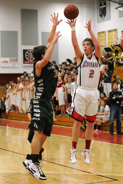 Loveland High School junior Ryan Andrews, right, shoots a jump shot over Fossil Ridge's Cody McCoy in the second quarter of their game Tuesday, Feb. 14, 2012 at LHS.