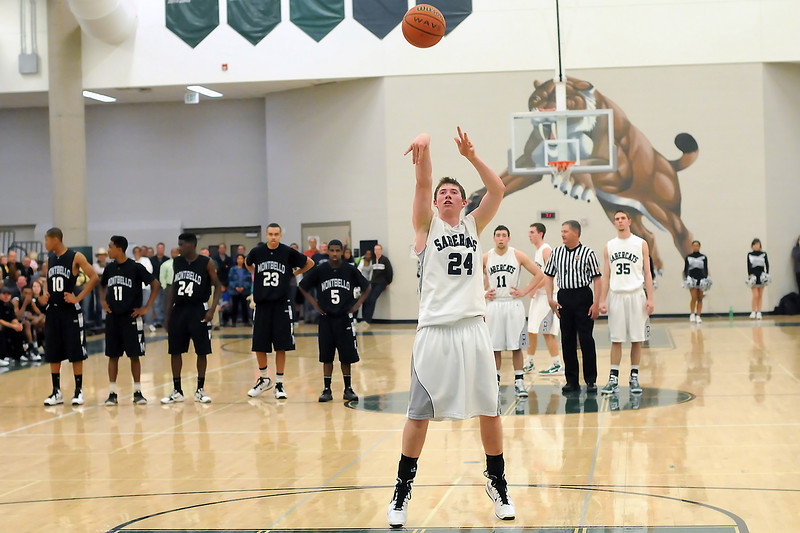 Fossil Ridge High School senior Chris Hansen (24) shoots a free throw in the fourth quarter of a game against Montbello on Wednesday, Mar. 2, 2011 at FRHS. The SaberCats won, 60-57.