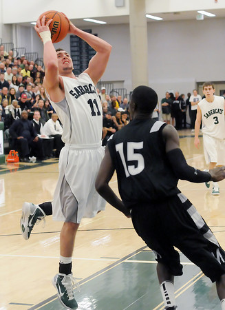 Fossil Ridge High School senior Zach Chavez-Levett (11) puts up a shot in the third quarter of a game against Montbello on Wednesday, Mar. 2, 2011 at FRHS. The SaberCats won, 60-57.