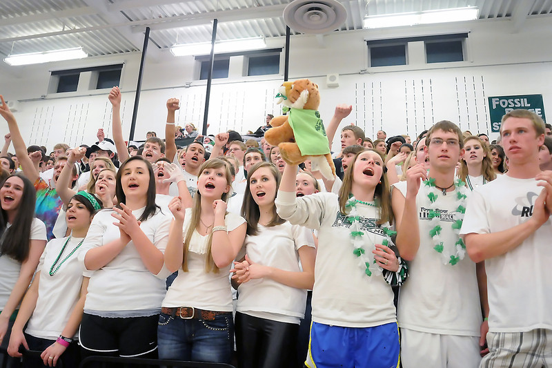 Fossil Ridge High School basketball fans cheer on the team during a timeout in the fourth quarter of a game against Montbello on Wednesday, Mar. 2, 2011 at FRHS. The SaberCats won, 60-57.