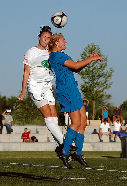 Colorado Force#18 Hope Siffert, left, and Colorado Rush #25 Lindsey Horan go up for a header Monday during their game at the Loveland Sport Park.