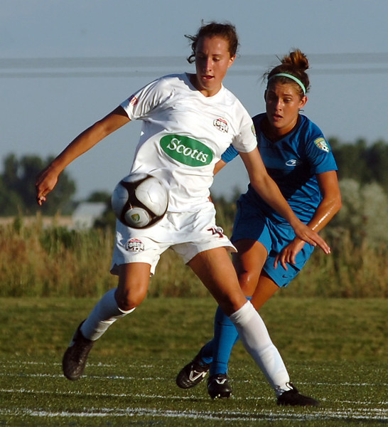 Colorado Force#11 Taylor Patterson, left, and Colorado Rush #4 Amy Steiner try to get control of the ball Monday during their game at the Loveland Sports Park.
