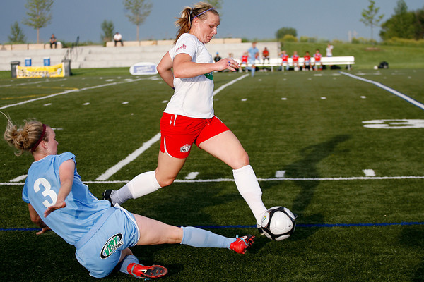 Colorado Force's Lisa Franke (10) has the ball knocked away from her by Pali Blues' Michelle Wenino (3) during the first half of their game Thursday, June 10 at the Loveland Sports Park.