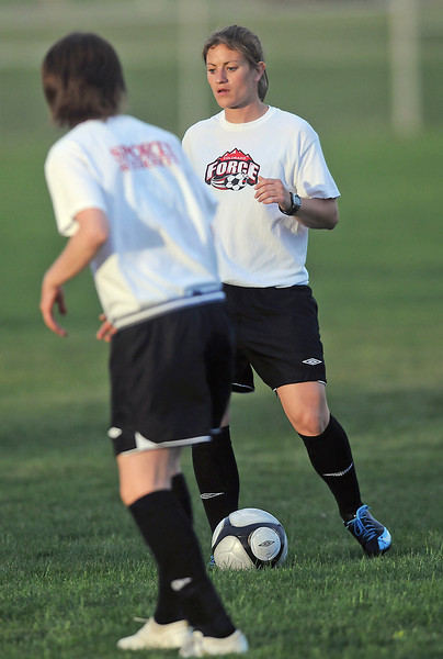 Colorado Force teammates Ashley Braam, back, and Zoe Avner work on a drill together during practice Tuesday at Fossil Ridge High School in Fort Collins.