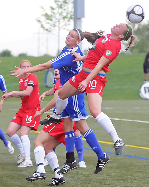 Colorado Force forward Lisa Franke, right, goes up for a header in the first half of a game against the Seattle Sounders on Friday, June 4, 2010 at the Loveland Sports Park.